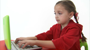 Eight year old girl surfing the Web